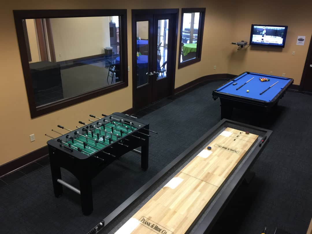 Bluegrass Karting game room with pool table, foosball table, and shuffleboard table